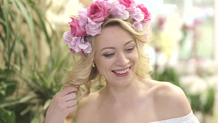 Beautiful girl with flowers on her head | Shutterstock HD Video #1010117972