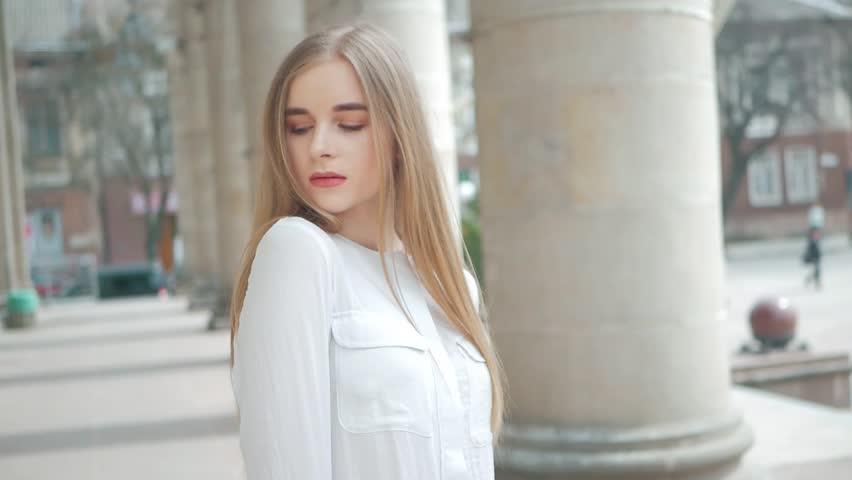 Summer lifestyle fashion portrait of young beautiful blonde stylish hipster woman wearing white shirt   Shutterstock HD Video #1010148272