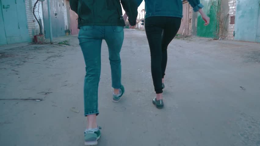 Two girls running around the garage. shake camera effect   Shutterstock HD Video #1010150642
