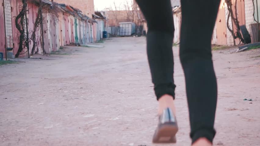 Two girls running around the garage.   Shutterstock HD Video #1010150672