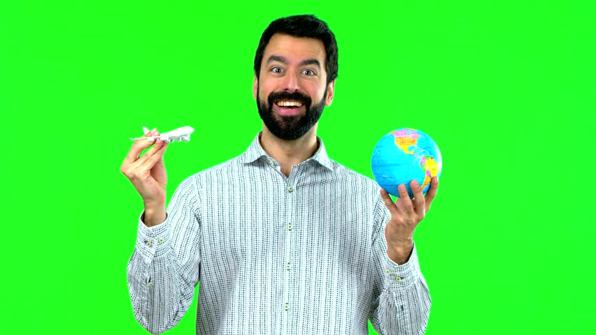 Man holding a toy airplane on green screen chroma key | Shutterstock HD Video #1010155652