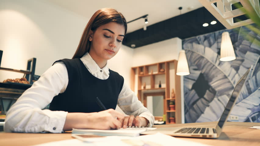 The attractive woman working at the desktop with a modern laptop   Shutterstock HD Video #1010184242