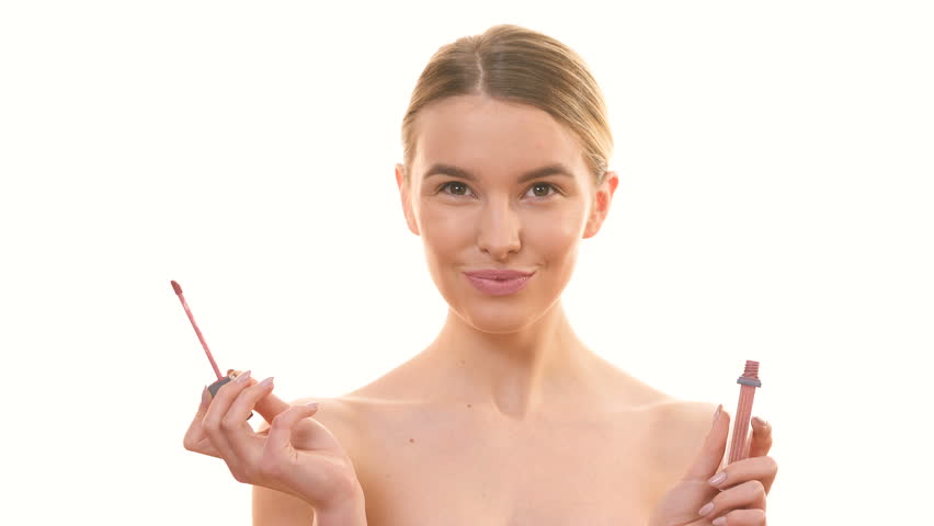 The woman with a lipstick laughing on the white background   Shutterstock HD Video #1010184692
