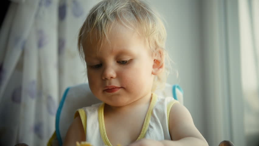 Baby eating pancake   Shutterstock HD Video #1010185142