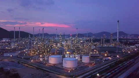 Oil and gas chemical tank with oil refinery plant background at twilight, 4K
