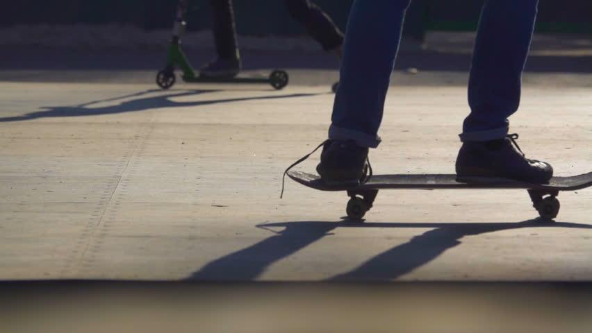 Legs of teenagers skateboarding in a skate park. Close up shot. Slow motion   Shutterstock HD Video #1010224082