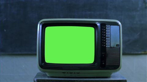 """80s Television with Green Screen in the Classroom. Night Tone.  You can replace green screen with the footage or picture you want with """"Keying"""" effect in AE  (check out tutorials on YouTube)."""