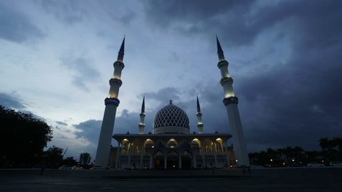 Time lapse of dramatic cloud movement at mosque during cloudy morning.