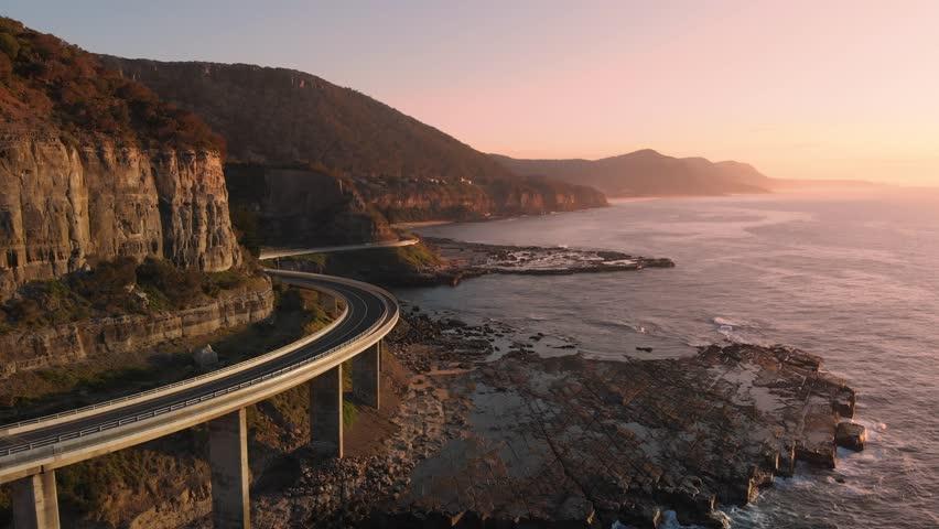 Australia aerial footage NSW sunrise sea cliff bridge coastal landscape