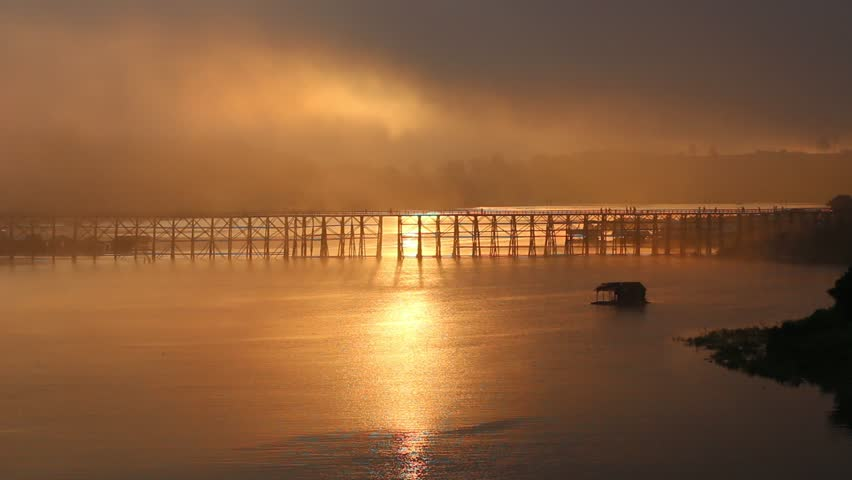 The vast river have is a long wooden bridge and floating house under the bridge In the morning there is sunshine Beautiful Contrast.   Shutterstock HD Video #1010360342