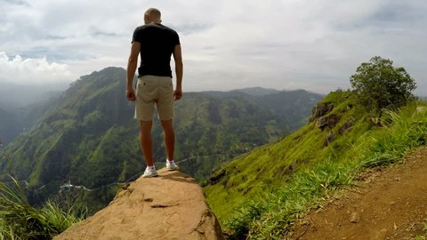 Traveler man enjoy mountains landscape. Travel concept vacations hiking in mountains,  Little Adam`s Peak, Ella, Sri Lanka