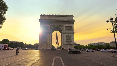 Paris, France - 5 May, 2017: Arch Of Triumph and Traffic at sunset in Paris France.Cinematic Steadicam Motion
