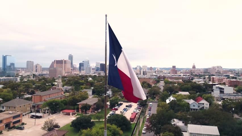 4K Texas Flag Orbiting Aerial at Sunset Austin