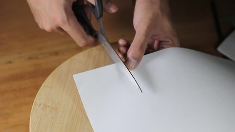 Cutting paper with scissors video
