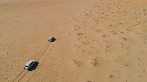 Jeeps traveling in the desert