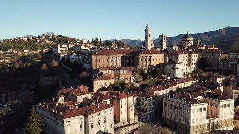 Drone aerial view of Bergamo - Old city. One of the beautiful town in Italy. Landscape on the city center and its historical buildings during a wonderful blu day