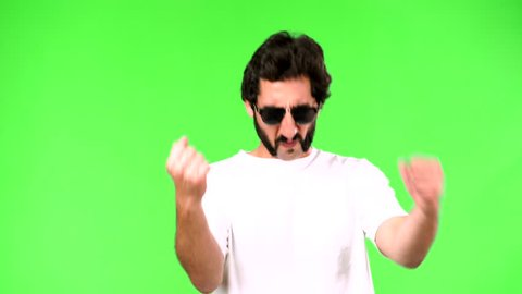 young crazy man with a rare beard celebrating or victory sign. cutout against green chroma background