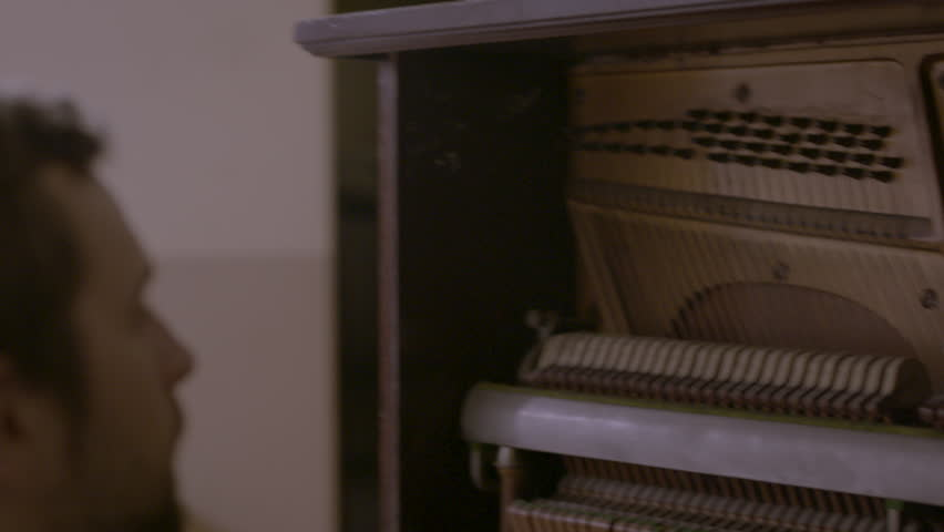 Close up of male musician playing the piano HD stock video. Alexa camera
