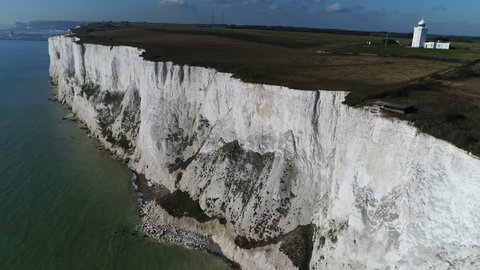 Aerial footage White Cliffs of Dover and South Foreland Lighthouse a Victorian lighthouse on South Foreland in St. Margarets Bay Dover Kent England used to warn ships approaching nearby Goodwin Sands
