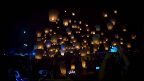 Taipei, Taiwan-02 March, 2018: 4K Tourist people foreigner traveling for launching many asian fire lanterns during buddhist festival in chinese new year. Rice paper hot air balloons in sky lantern-Dan