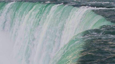 Slow Motion Bird Flying Past Waterfall at Niagara Falls, Ontario, Canada