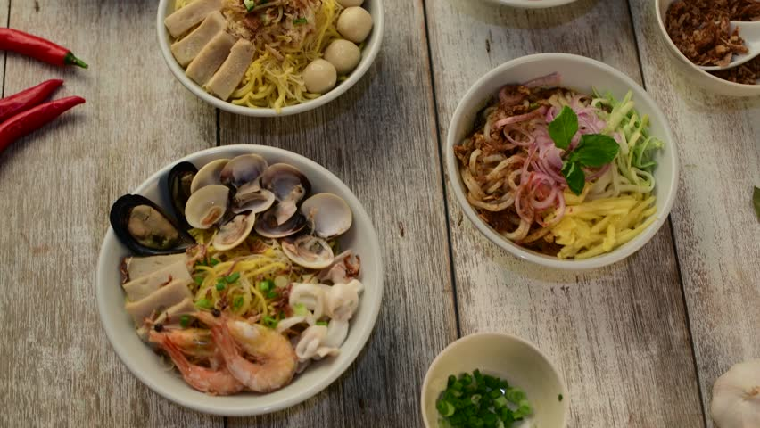 Various malaysian noodles top up view  | Shutterstock HD Video #1010546972