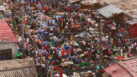Close-up shot of the Lixeira (landfill) slum market at sunset in Luanda, Angola.