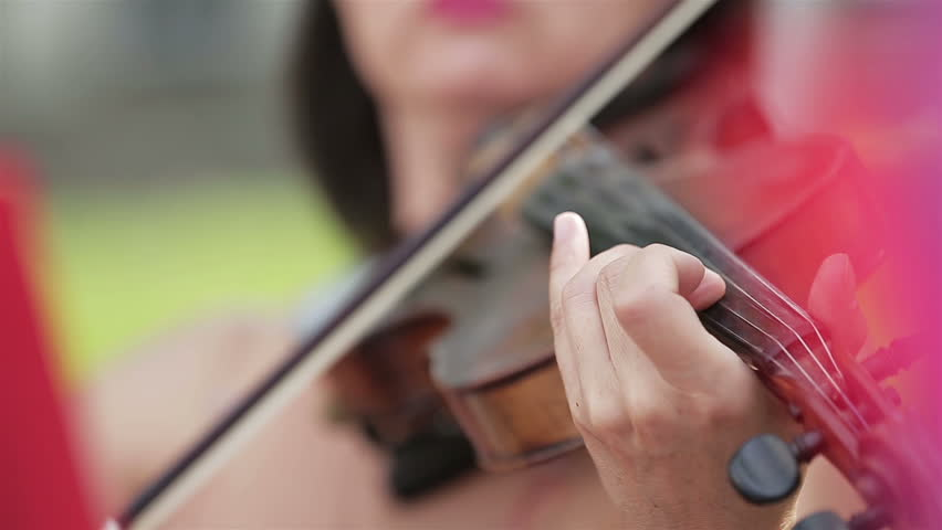Woman playing the violin in extremely close up shot | Shutterstock HD Video #1010564642