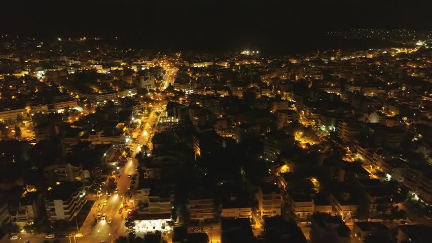Aerial night skyline  Athens Greece, southern suburbs.Aerial nigh establishing shot of buildings and traffic in the southern suburbs of Athens. | Shutterstock HD Video #1010572082