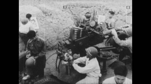 VIETNAM 1960s: Soldiers gather around anti-aircraft gun. Girl delivers flowers to soldiers. Soldier hugs girl and comarades clap. Men and women interact with militia.