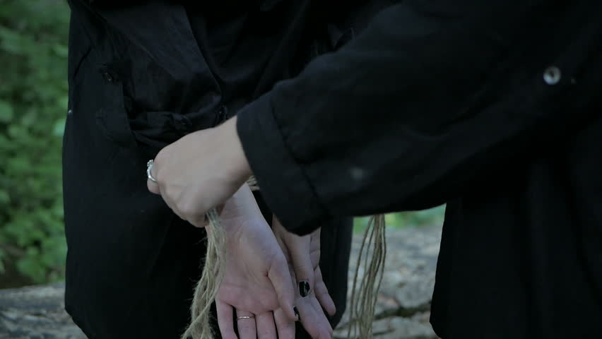 Crazy Girl binds a woman's hands with a rope