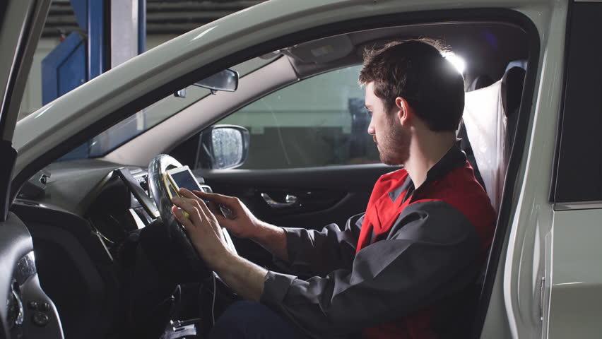 Mechanic Is Using Modern Technologies in the Workshop | Shutterstock HD Video #1010621252