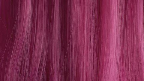 Closeup of pink hair creative colored texture. Pink hair combbing
