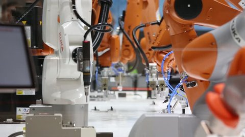 Hannover, Germany - April, 2018: Automation solutions of the future with robot arms on Kuka stand on Messe fair in Hannover, Germany