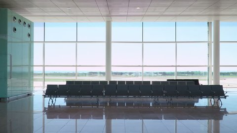 Airplane takes off from Airport. View from Airport Terminal Waiting Area. 4K Video Clip