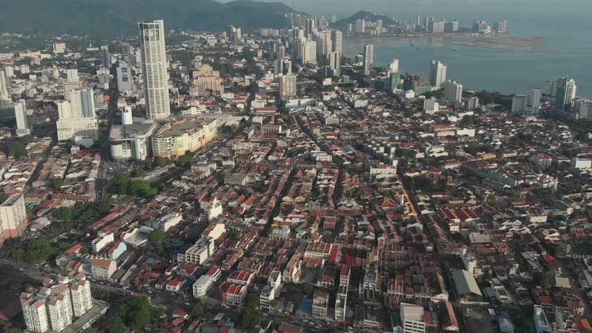 Aerial view of Georgetown, Penang, Malaysia from Clan Jetties. Once an important Straits of Malacca trading hub, it is known for its British colonial buildings, Chinese shophouses and mosques.