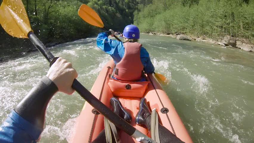 Two people on rafting on mountain river at spring time. Extreme professional water sport  | Shutterstock HD Video #1010768492