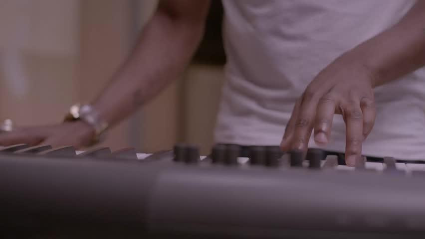 Close-up of Dj mixing music with his keyboard HD stock video. Alexa camera