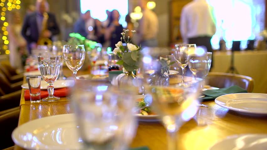 Table with food variety invited to a celebration of people. Banquet feast with dishes and served food. slow-motion | Shutterstock HD Video #1010894192