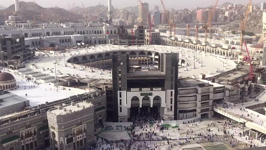 MECCA, SAUDI ARABIA - MAY 05 2018: Crowd of people walking around Masjid Al Haram in Mecca. Top aerial skyline view from Abraj al Bait tower. During Umrah or Hajj. Time after Asr prayer.