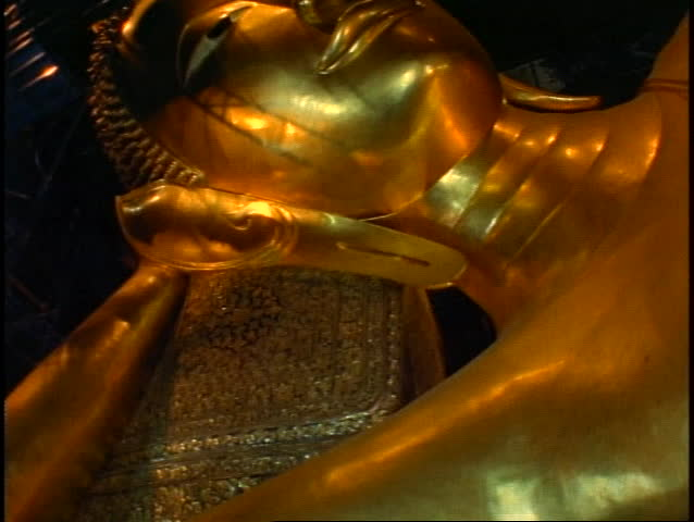 THAILAND, 1999, Temple of the Reclining Buddha, The Golden Buddha, close up face of gold, tilt