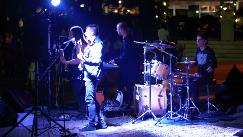 YALTA, RUSSIA, MAY 1, 2018: Street rock band plays electric guitars, drums and sing songs at night. Embankment of Yalta, Crimea.