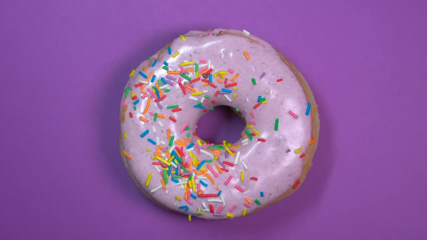 Bright and Colorful Sprinkles Donut Stock Footage Video (100% Royalty-free)  1010962652 | Shutterstock