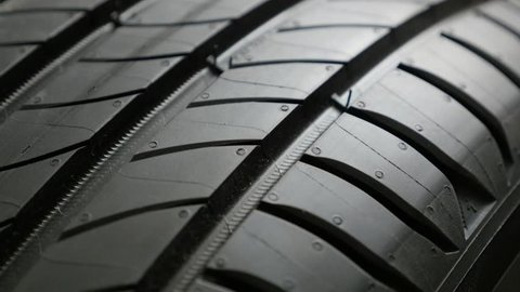 Close-up of tread pattern on tyre surface 4K footage