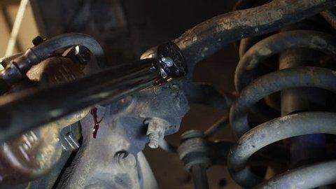 Using a Torque Wrench to Tighten Automobile Disc Brake Caliper Bolt