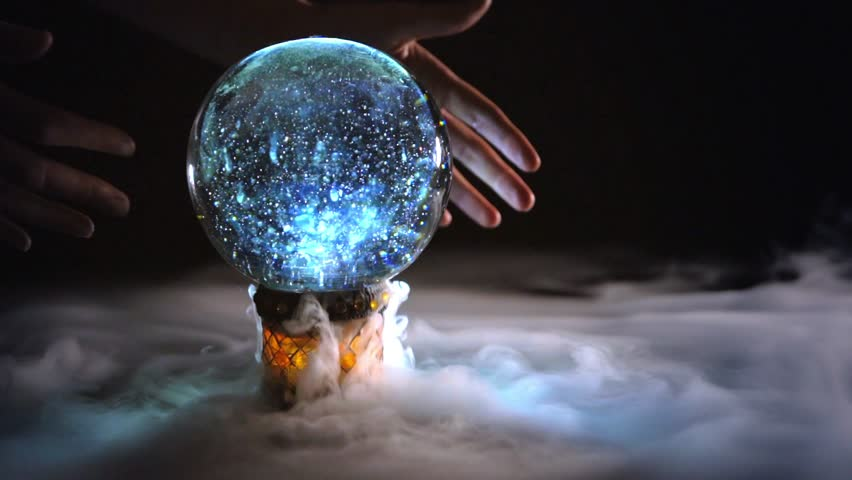 4K mysterious hands circling glowing crystal ball box with mist / fog / smoke on black background