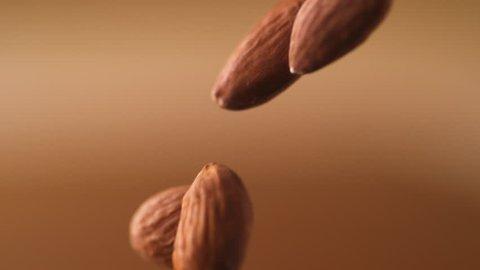 Almonds falling. Shot with high speed camera, phantom flex 4K. Slow Motion.