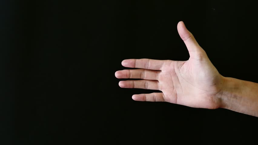 Male hands gesture on black background.