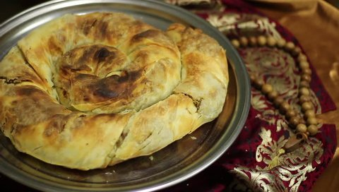 Ramadan Fasting. Iftar meal. Burma is a dish of Crimean Tatar cuisine, in the form of a roll with a filling