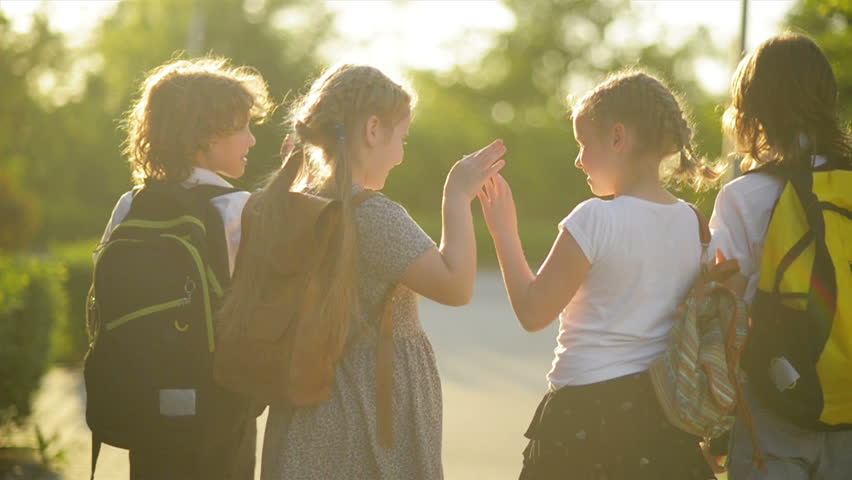 Four Friends Are Going to School. They Have A Lot of Fun Because Today is Their First Day at School. | Shutterstock HD Video #1011215672